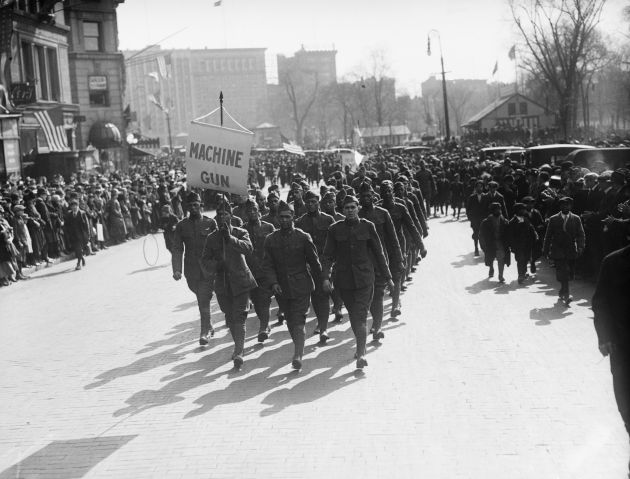 Soldiers Marching with Machine Gun Sign