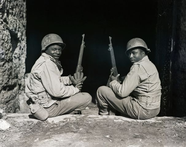 Two Black Soldiers Seated W/Rifles