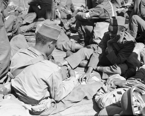 Troops Playing Cards on Ship