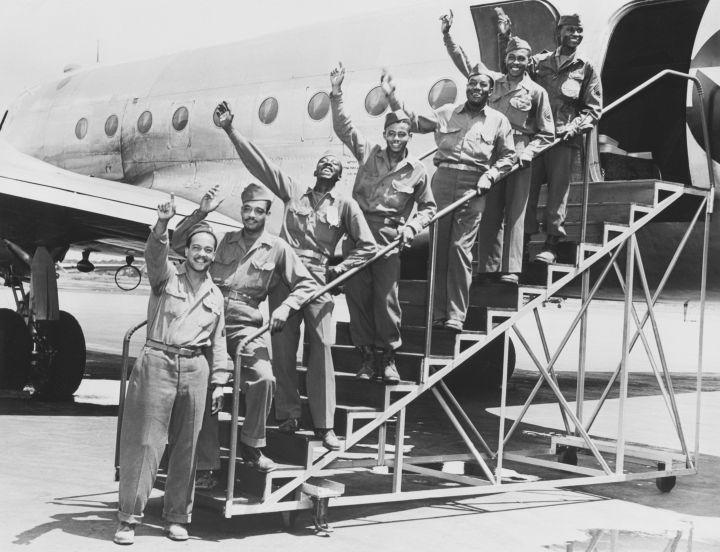 Tuskegee Airmen Waving on Gangway