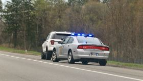 Police vehicle stop a speeding motorist on a rural highway