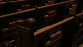 Close-up of wooden church pews