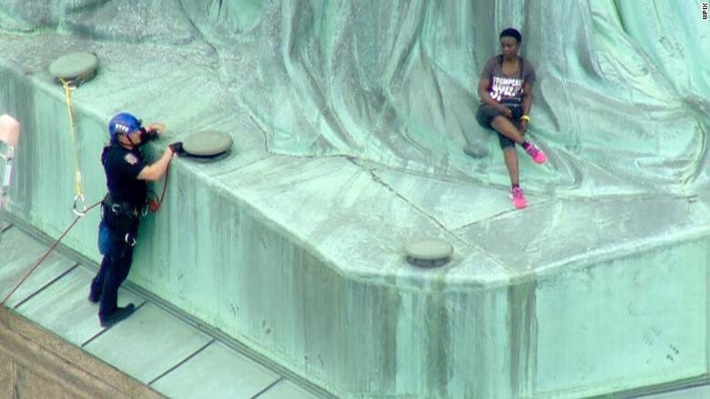 Therese Patricia Okoumou scales the Statue of Liberty on July 4, 2018