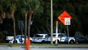 Orlando police officer shot; suspect has 4 children as hostages