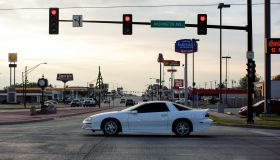 Red traffic light and city street at Weatherford, Oklahoma, USA
