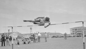 Alice Coachman up and over High Jump Bar