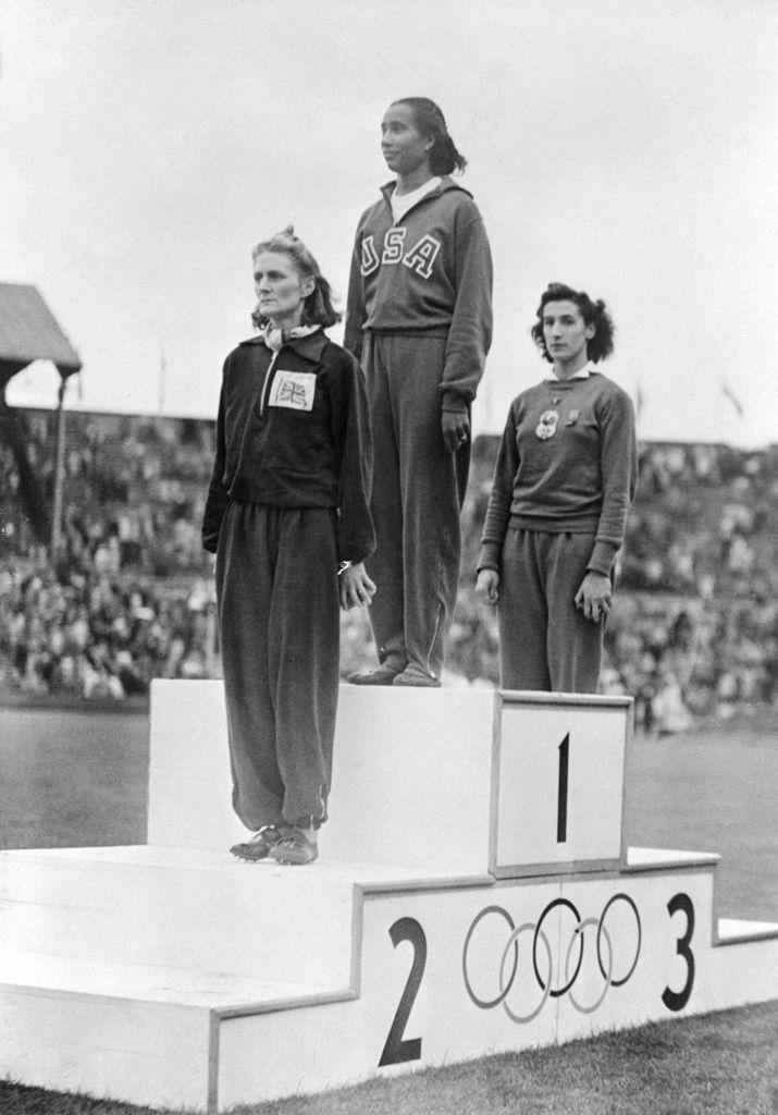 Women Olympic Winners Standing for Awards