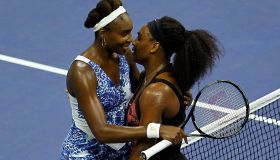 Serena Williams of the U.S. embraces her sister Venus Williams at the net after defeating her in the