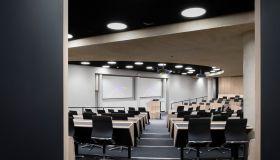 Lecture theatre. The Blavatnik School of Government at the University of Oxford, Oxford, United Kingdom. Architect: Herzog & De Meuron, 2016.