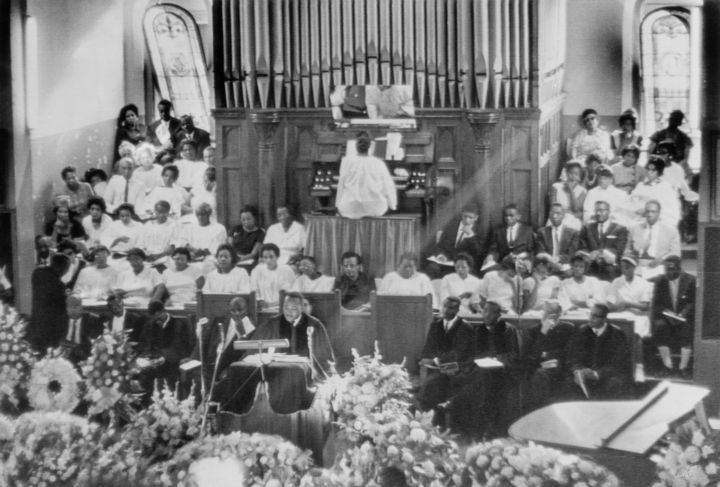 Martin Luther King Conducting Funeral Service