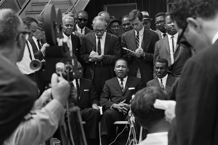Martin L. King Seated Addressing Camera