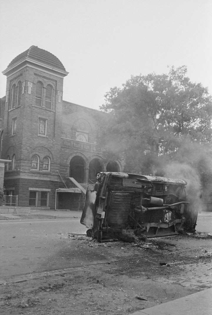 Bombed Car in Front of Church
