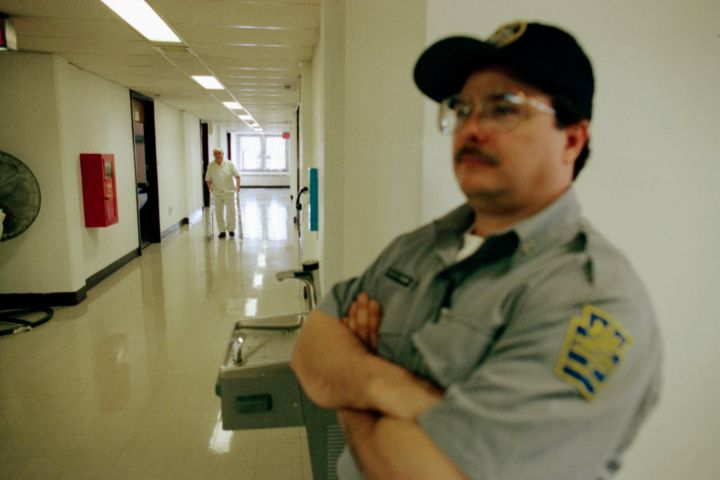 Prison Guard in Hallway
