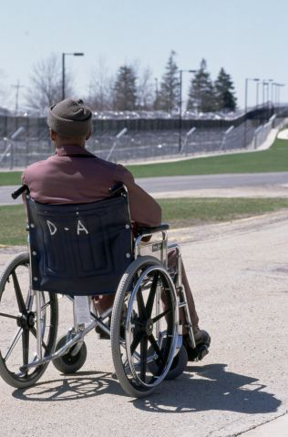 Wheelchair Bound Prisoner Gazing Across Laurel Highlands Yard