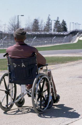 Wheelchair Bound Prisoner Gazing Across Laurel Highlands Yard