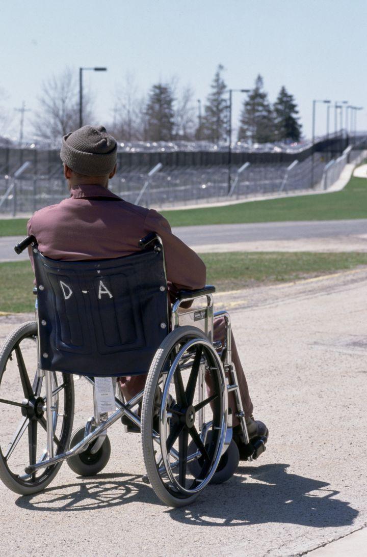 Wheelchair Bound Prisoner Gazing Across SCI Laurel Highlands Prison Yard