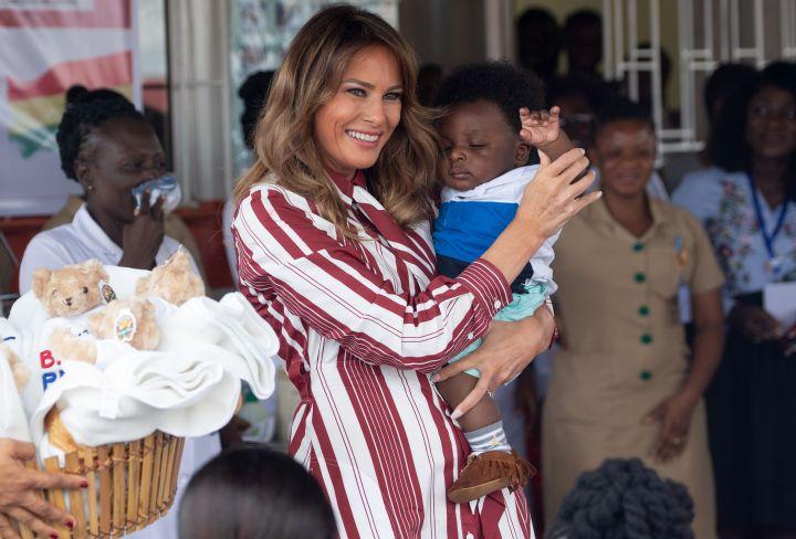 Melania Trump holds a baby