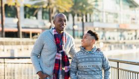 African-American father and son in city