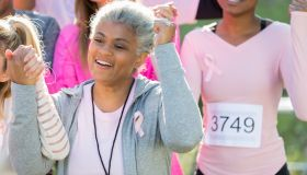 Senior breast cancer survivor during charity event