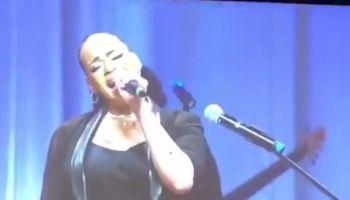 Faith Evans singing at Kim Porter's funeral