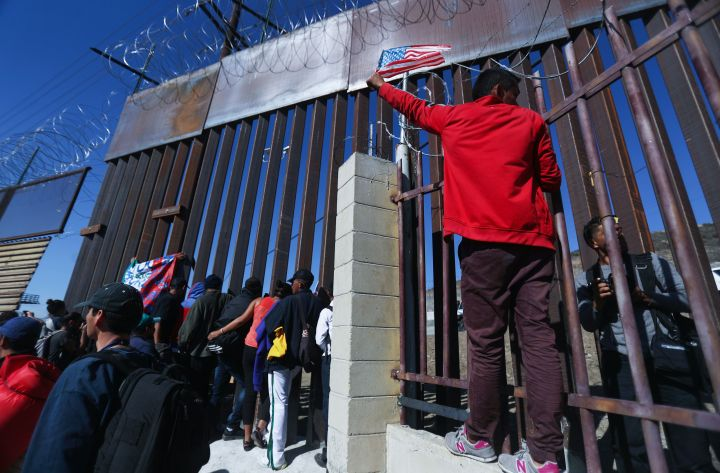 Immigrant Caravan Members Gather At U.S.-Mexico Border