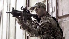 Lone African American Male soldier in outdoor setting
