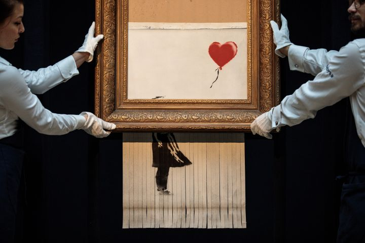 Sotheby's Unveils Banksy's Newly Completed Artwork 'Love in in the Bin'