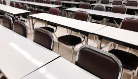 Empty Chairs Arranged At Tables In Lecture Hall