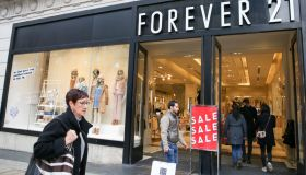 Shoppers are seen outside Forever 21 store on London's...