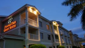 The exterior of Hilton Doubletree Guest Suites at night