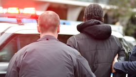 NYPD officers are seen arresting a bike messenger for...