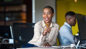 Successful businesswoman working at her desk