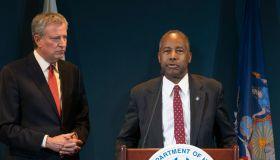 Mayor Bill de Blasio listens as Secretary of US HUD Ben...