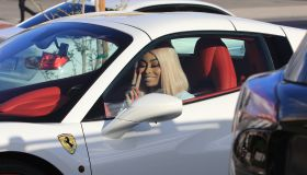 Blac Chyna gets into her white Ferrari while out and about