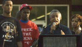 Reverend Al Sharpton (2nd-R) speaks with
