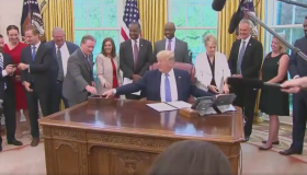 Ben Carson, Tim Scott and Trump in the Oval Office