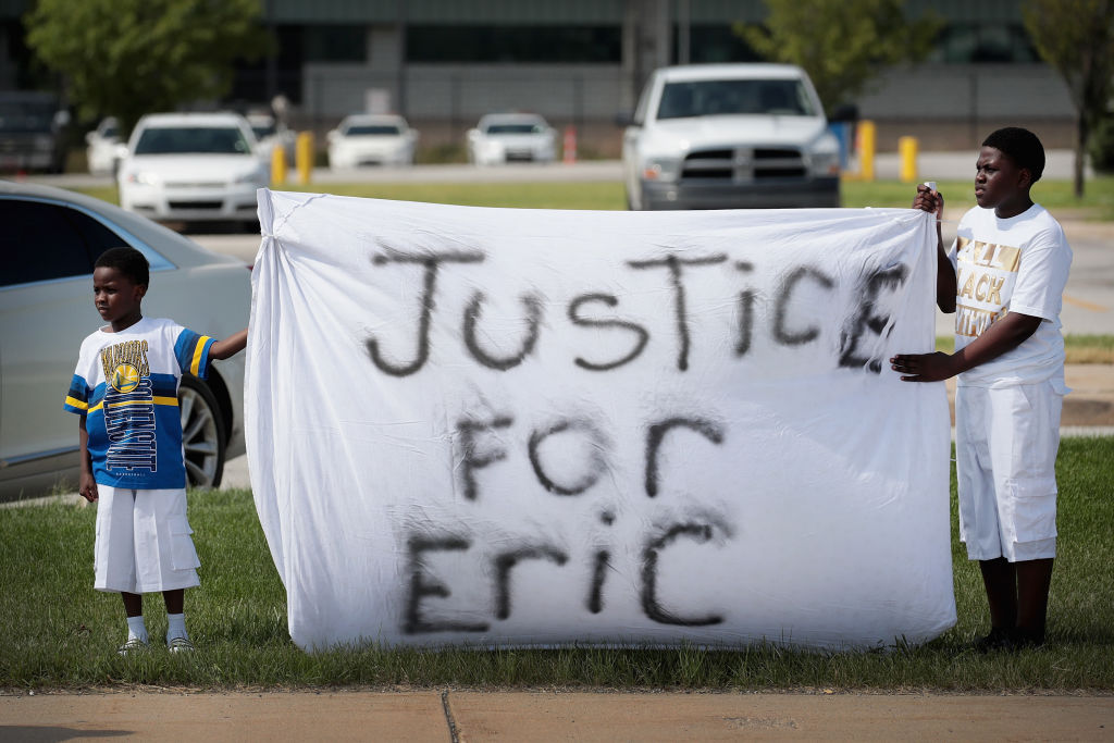 Demonstrators Hold A Protest Outside South Bend Police Station After Funeral For Eric Logan