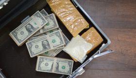 Drug and Dollar Money in suitcase, Drug trafficking, crime.