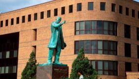 Booker T. Washington Monument with William & Norma Harvey Library beyond, Hampton University, Virginia.