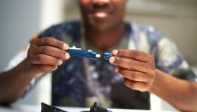 African American male using a glucose tester