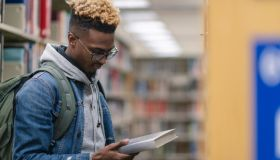 University Male of African Descent finding a book