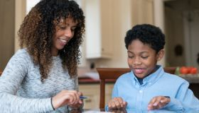 Mother and Son of African Descent Working on Homework Together