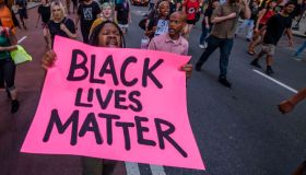 Protesters marching in the streets - Community organizations...