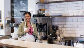 African-American woman working in coffee shop