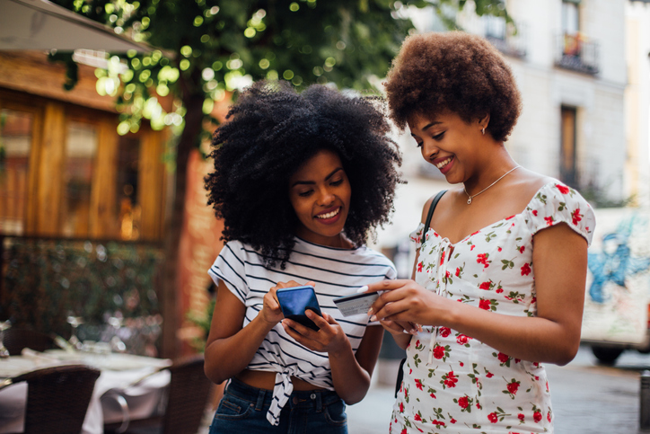 Two girls shop online
