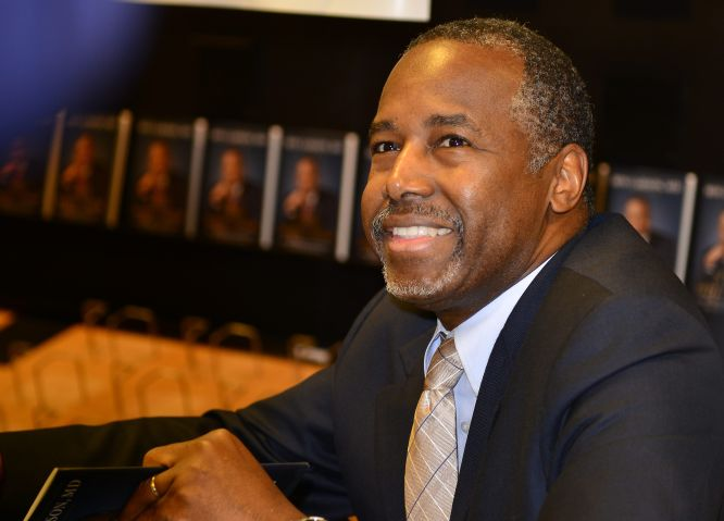 Photo Shows Ben Carson Standing So MAGA Men Can Sit On Rosa Parks' Birthday