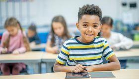 African Boy Using a Digital Slate stock photo