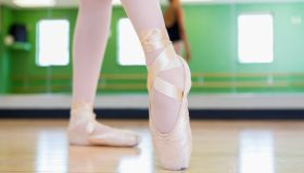 Mixed race ballerina practicing in studio