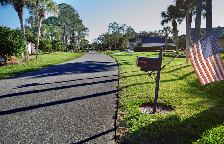 A suburban street with US flags in Florida, USA