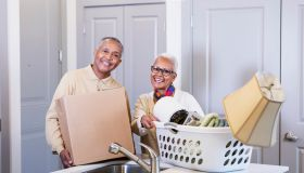 Senior African-American couple moving house